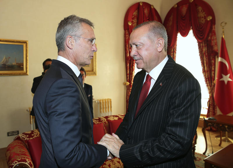NATO Secretary General Jens Stoltenberg, left, with Turkey's President Recep Tayyip Erdogan before a meeting, in Istanbul, Friday, Oct. 11, 2019. NATO's secretary-general says Friday he acknowledges Turkey's legitimate security concerns but has urged Ankara to exercise restraint in its incursion into northeast Syria.(Presidential Press Service via AP, Pool)