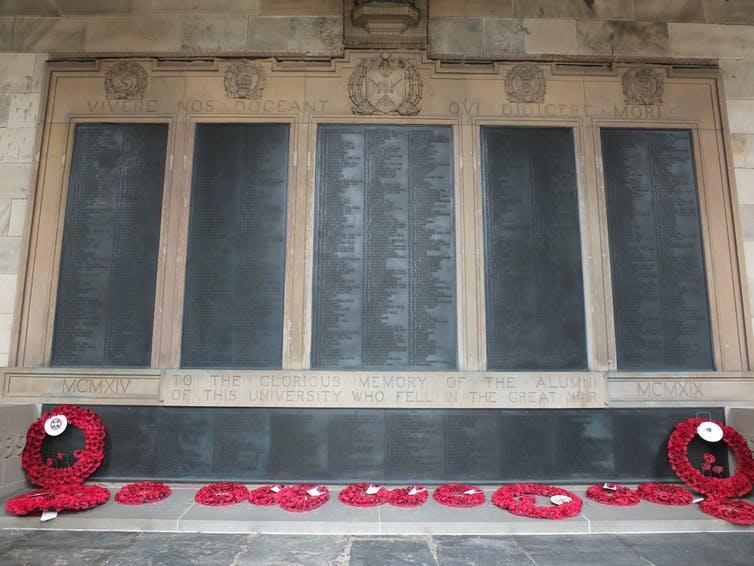 Poppy wreaths lie at the foot of the Old College war memorial at the University of Edinburgh