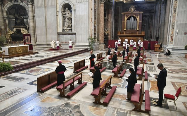 Pope Francis leads a socially distanced Mass