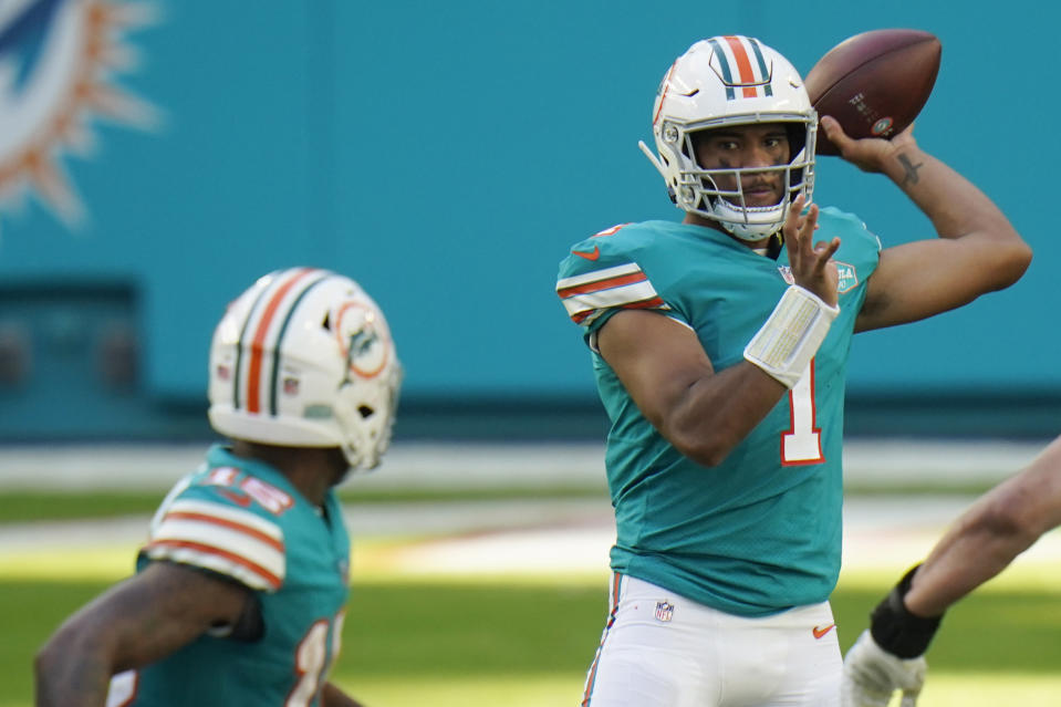 Miami Dolphins quarterback Tua Tagovailoa (1) has nine touchdown passes and three touchdown runs this season. (AP Photo/Chris O'Meara)