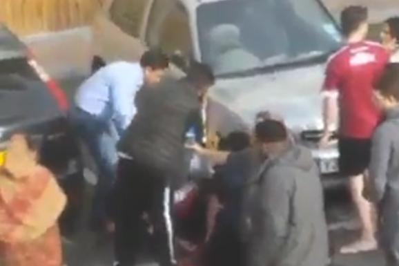 Stabbing: A crowd of people desperately tried to help the young man as he lay on the ground (@RahManItsEmz)