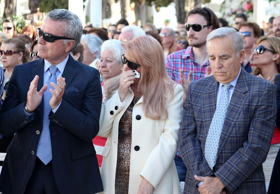 CHIPIONA, SPAIN - MAY 04:  (L-R) Jose Ortega Cano, Gloria Mohedano and Jose Antonio Rodriguez attend the mass for Rocio Jurado in her International Day at San Jose Graveyard on May 4, 2013 in Chipiona, Spain.  (Photo by Europa Press/Europa Press via Getty Images)