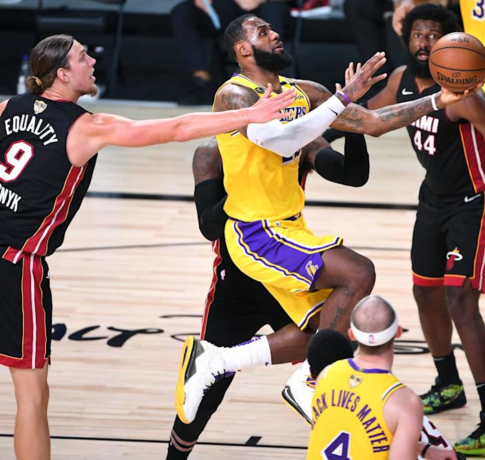 Lakers forward LeBron James drives down the lane for a layup during Game 1.