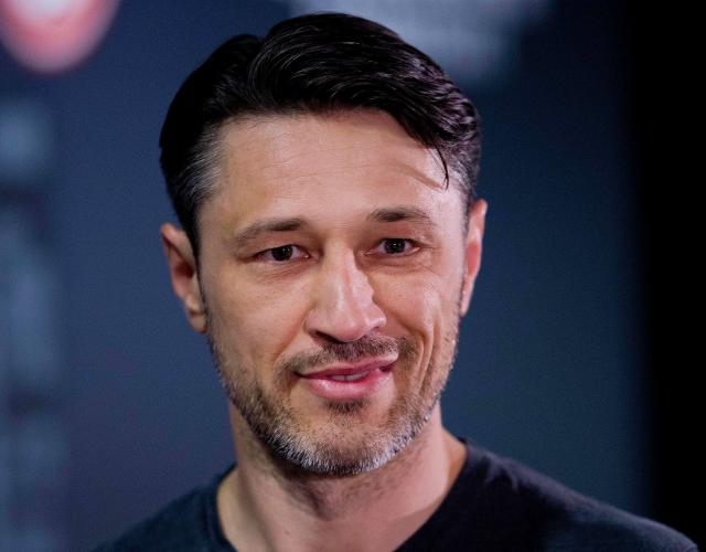FILE - In this April 13, 2018 file photo coach of Eintracht Frankfurt Niko Kovac arrives for a press conference to announce that he will become the new coach of Bayern Munich in Frankfurt, Germany. Bayern Munich will get a good look at its next coach when Eintracht Frankfurt visits for a rehearsal of the German Cup final on Saturday April 28, 2018. Kovacs switch has soured relations between the clubs even if both now insist that bygones are bygones. (AP Photo/Michael Probst,file)