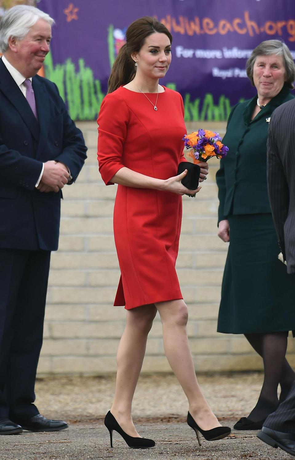 <p>Kate attended a charity event in Norfolk wearing a vibrant red dress by Katherine Hooker, black Jimmy Choos and a Stuart Weitzman bag. </p><p><i>[Photo: PA]</i></p>