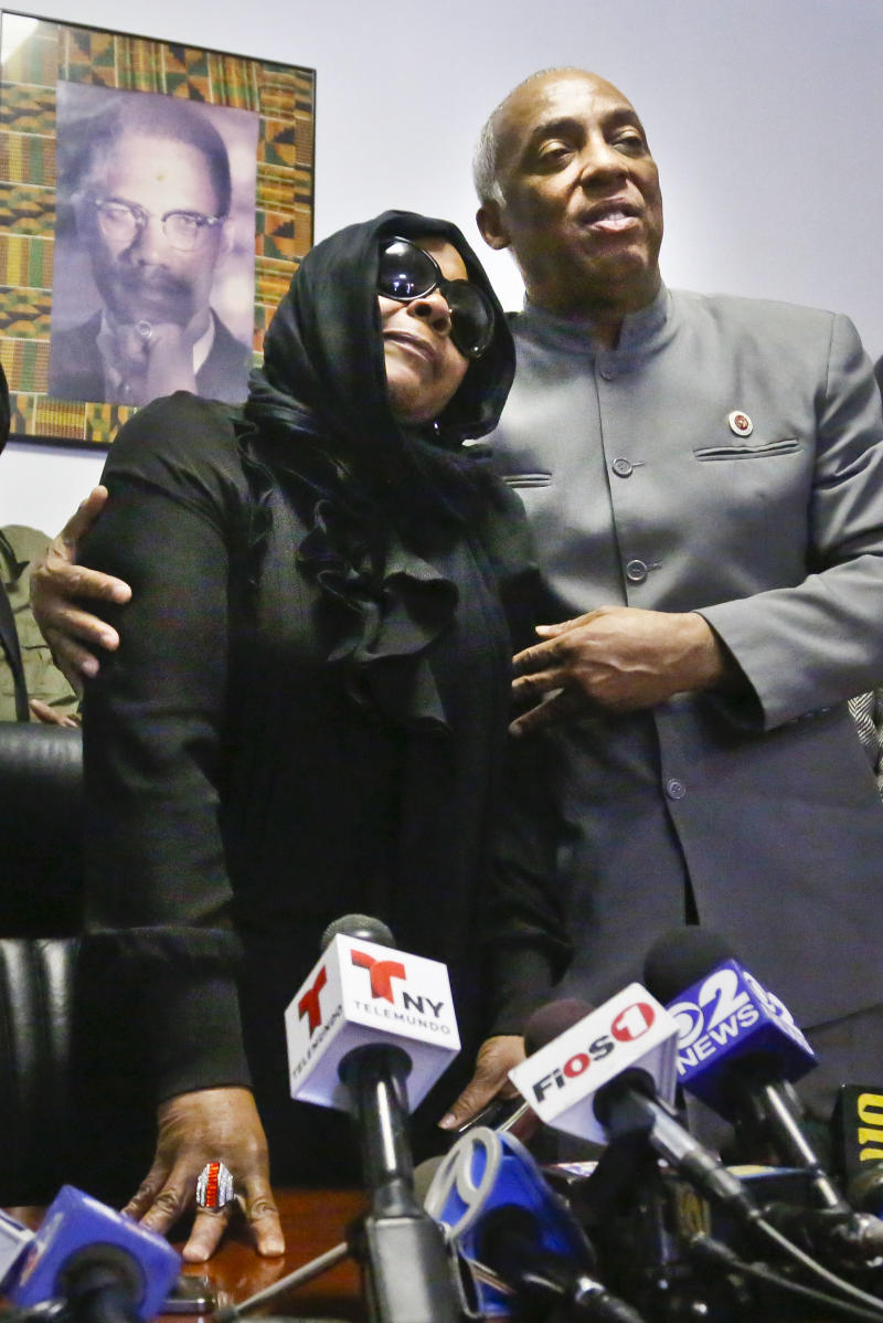 "Carol Gray, left, leans on City Councilman Charles Barron, during a press conference on Thursday, March 14, 2013 in the East Flatbush neighborhood of Brooklyn, N.Y.  Gray's son Kimani ""Kiki"" Gray, 16, was shot to death on a Brooklyn street last Saturday night by plainclothes police officers who say the youth pointed a .38-caliber revolver at them, while Gray's family says he was unarmed. (AP Photo/Bebeto Matthews)"