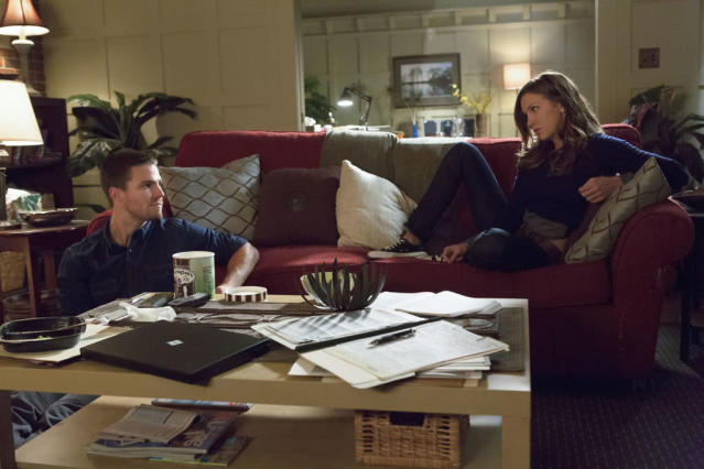 """""""Honor Thy Father"""" -- Stephen Amell as Oliver Queen and Katie Cassidy as Laurel"""