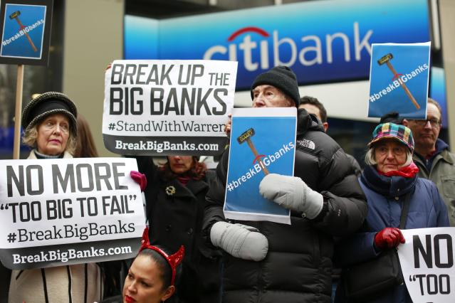 Demonstrators stand outside the Citigroup headquarters during a rally in support of Senator Warren's message for the need to break up the big banks. December 18, 2014. (REUTERS/Shannon Stapleton)