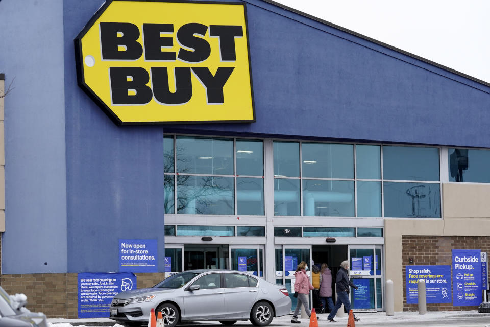 Shoppers enter and exit Best Buy store in Arlington Heights, Ill., Saturday, Feb. 6, 2021. Best Buy is closing five stores in four states in the next month. The retailer plans to close two Richmond, Va., area stores, along with one store each in Syracuse, N.Y., Carbondale, Ill., and Brockton, Mass. (AP Photo/Nam Y. Huh)