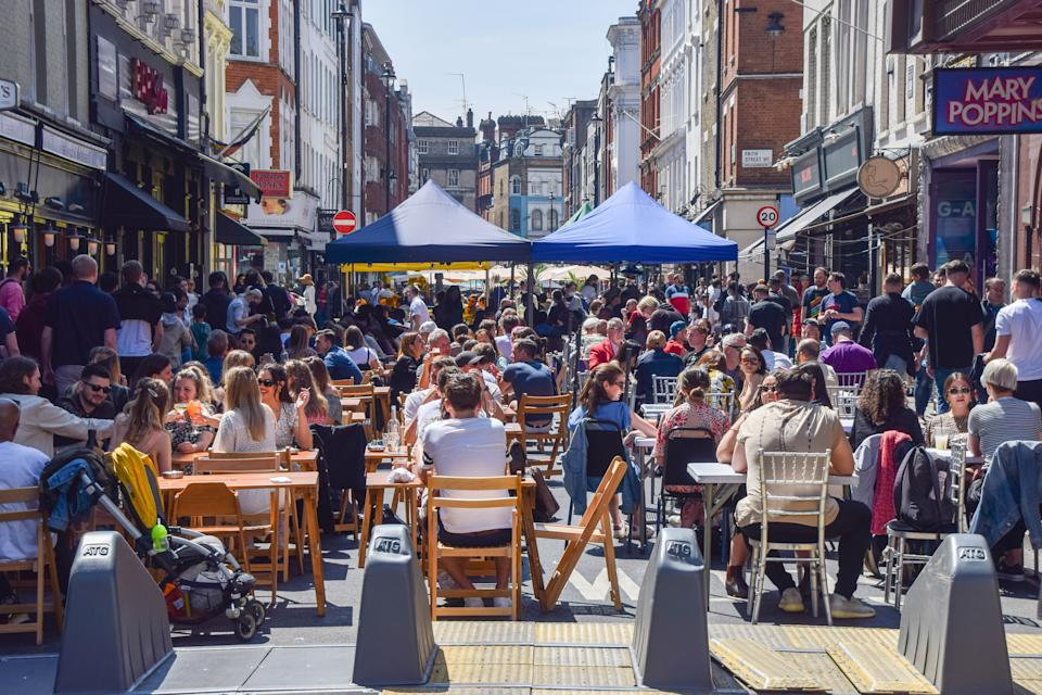 Busy restaurants in Old Compton Street, Soho. Crowds of people flocked to the cafes and restaurants in Central London as temperatures rose over the bank holiday weekend. (Photo by Vuk Valcic / SOPA Images/Sipa USA)