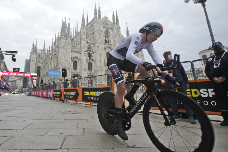 Britain's Tao Geoghegan Hart rides past the gothic cathedral after completing the final stage of the Giro d'Italia cycling race, a 15.7 kilometers (9.756 miles) individual time trial from Cernusco sul Naviglio to Milan, Italy, Sunday, Oct. 25, 2020. (AP Photo/Luca Bruno)
