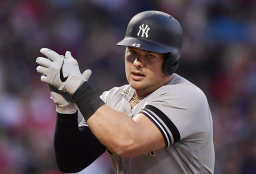 New York Yankees' Luke Voit claps as he scores after hitting a solo home run during the first inning of a baseball game against the Los Angeles Angels, Monday, April 22, 2019, in Anaheim, Calif. (AP Photo/Mark J. Terrill)
