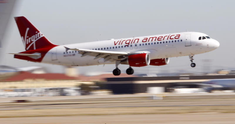 Virgin America's inaugural flight between Los Angeles an Dallas Fort Worth International Airport comes in for a landing in Grapevine, Texas  Wednesday, Dec. 1, 2010. Virgin will be serving air routes between DFW and San Francisco-Los Angeles.  (AP Photo/LM Otero)