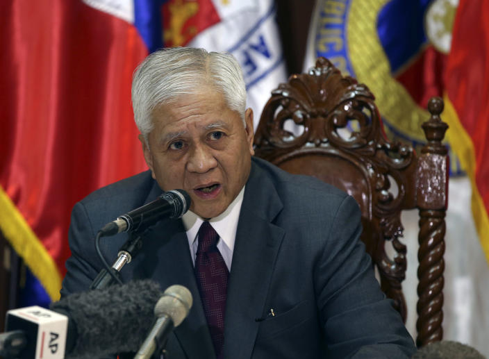 Philippine Foreign Secretary Albert del Rosario delivers his statement to reporters at Camp Aguinaldo military headquarters in suburban Quezon City, north of Manila, Philippines on Monday, Aug. 12, 2013. Philippine officials said Monday they will make sure that an increased presence of U.S. troops in the country does not become permanent and is meant to help the Philippines modernize its military, which is being challenged by China in territorial disputes in the South China Sea. (AP Photo/Aaron Favila)