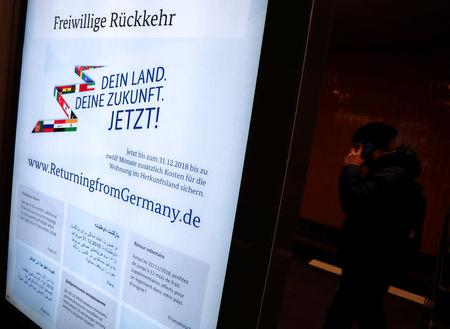 A poster advertising financial help to refugees who want to return to their home countries issued by Germany's Interior Ministry is pictured at a metro station in Berlin