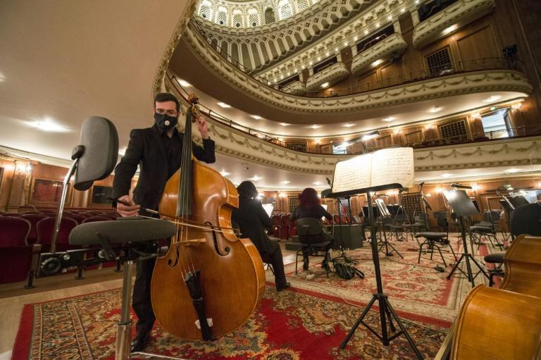 Despite the disinfectant, social-distancing and staff taking people's temperature, a festive spirit reigns at the historic opera house in the Bulgarian capital Sofia