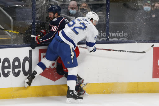 Tampa Bay Lightning's Callan Foote, right, checks Columbus Blue Jackets' Boone Jenner during the second period of an NHL hockey game Saturday, Jan. 23, 2021, in Columbus, Ohio. (AP Photo/Jay LaPrete)