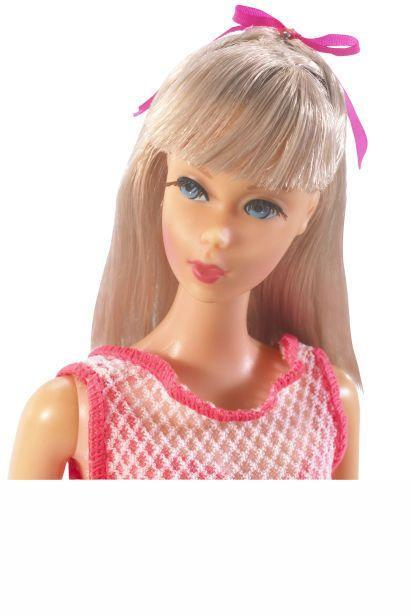 "<p>Like many other women this decade, Barbie Twist N Turn experiments with bangs. </p><p><a href=""http://www.goodhousekeeping.com/beauty/makeup/a33178/barbie-makeup-tutorial-video/"" rel=""nofollow noopener"" target=""_blank"" data-ylk=""slk:Watch an unbelievable Barbie makeover »"" class=""link rapid-noclick-resp""><em>Watch an unbelievable Barbie makeover »</em></a></p>"