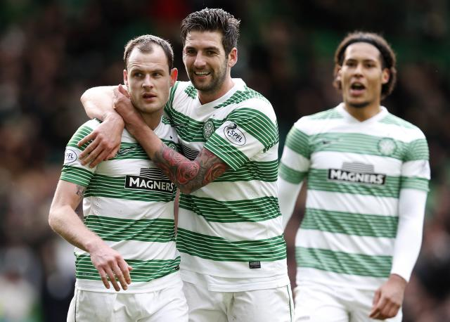 Celtic's Anthony Stokes (L) celebrates with Charlie Mulgrew his goal against St Mirren during their Scottish Premier League soccer match at Celtic Park Stadium, Glasgow, Scotland, March 22, 2014.REUTERS/Russell Cheyne (BRITAIN - Tags: SPORT SOCCER)