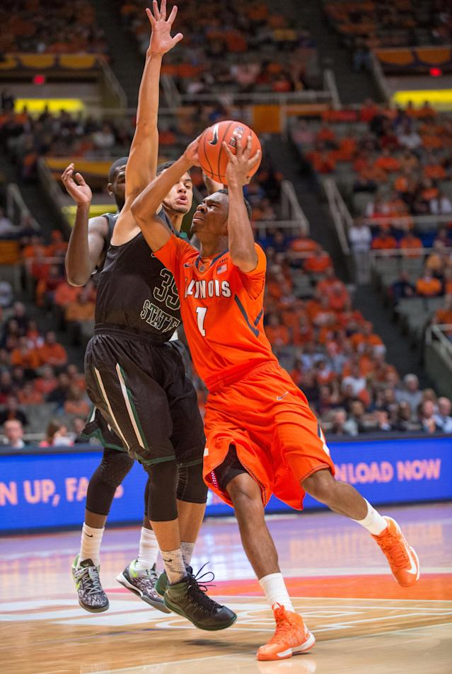 Chicago State's Clarke Rosenberg (35) tries to stop a shot by Illinois' Jaylon Tate (1) during the first half of an NCAA college basketball game on Friday, Nov. 22, 2013, in Champaign, Ill. (AP Photo/Darrell Hoemann)