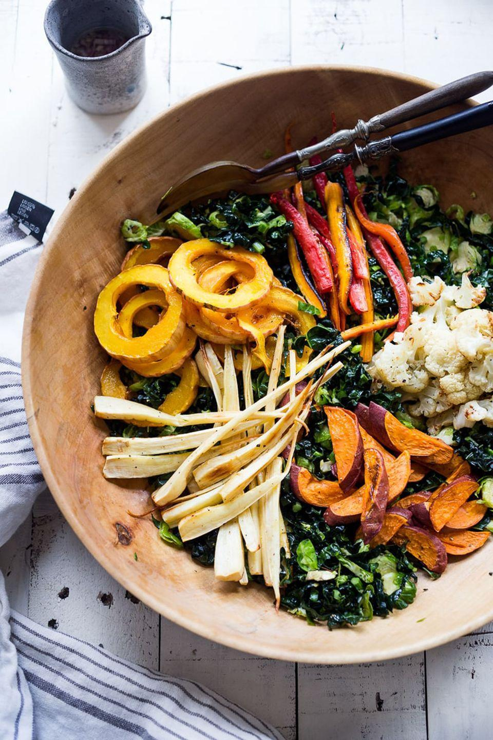 "<p>A hearty and <a href=""https://www.countryliving.com/food-drinks/g4710/thanksgiving-salad/"" rel=""nofollow noopener"" target=""_blank"" data-ylk=""slk:healthy salad"" class=""link rapid-noclick-resp"">healthy salad</a> will help you balance out a day of indulging.</p><p><strong>Get the recipe at <a href=""https://www.feastingathome.com/roasted-fall-vegetable-salad-maple-curry-dressing/"" rel=""nofollow noopener"" target=""_blank"" data-ylk=""slk:Feasting at Home"" class=""link rapid-noclick-resp"">Feasting at Home</a>.</strong> </p>"