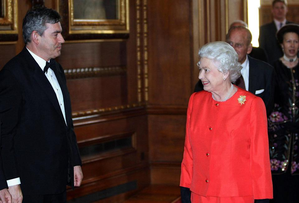 Britain's Queen Elizabeth II meets Prime Minister Gordon Brown as she hosts a reception to mark the centenary of the 1908 London Olympics at Windsor Castle in Berkshire [Photo: PA]