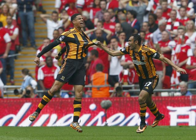Hull City's Curtis Davies (L) celebrates with team mate Ahmed Elmohamdy after scoring his team's second goal against Arsenal during their FA Cup final soccer match at Wembley Stadium in London, May 17, 2014. REUTERS/Eddie Keogh (BRITAIN - Tags: SPORT SOCCER)