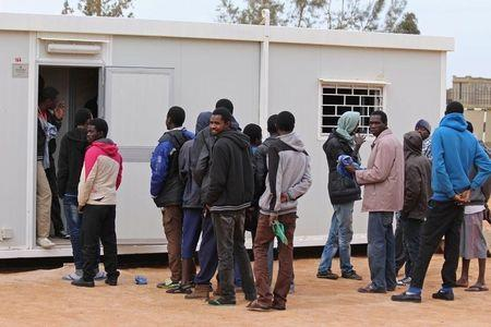 A group of Senegalese illegal immigrants, who according to authorities will be deported back to Senegal through the border with Tunisia, are held at the Alkarareem immigration centre in the east of Misrata February 26, 2015. REUTERS/Stringer