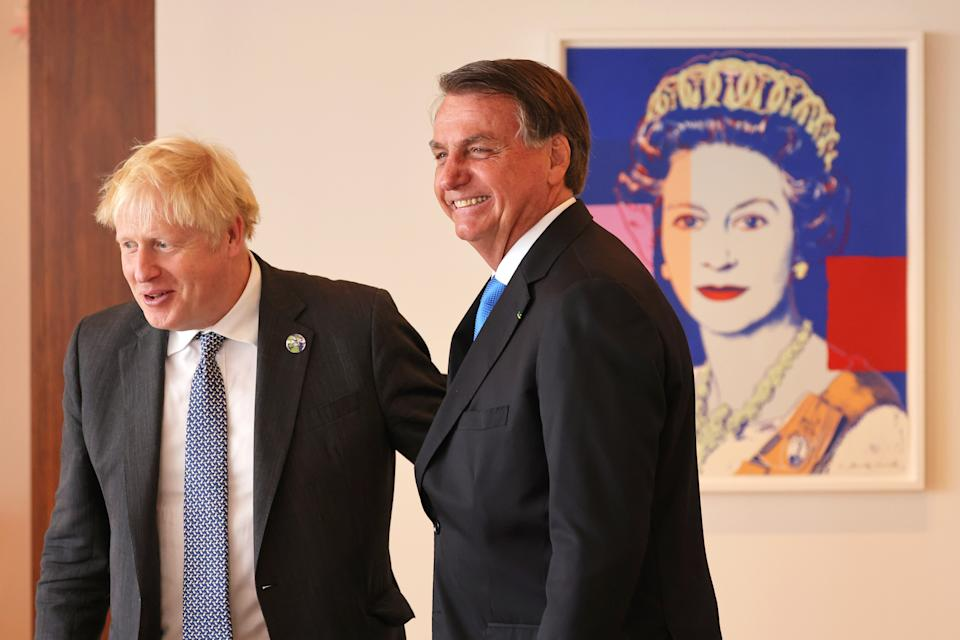 NEW YORK, NEW YORK - SEPTEMBER 20: British Prime Minister Boris Johnson and Brazil's president Jair Bolsonaro prepare to sit for a bilateral meeting at the UK diplomatic residence on September 20, 2021 in New York City. The British prime minister is one of more than 100 heads of state or government to attend the 76th session of the UN General Assembly in person, although the size of delegations are smaller due to the Covid-19 pandemic. (Photo by Michael M. Santiago-Pool/Getty Images)