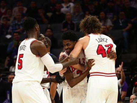 Feb 5, 2018; Sacramento, CA, USA; Chicago Bulls guard Justin Holiday (7) holds back center Robin Lopez (42) after he was ejected from the game during the second quarter against the Sacramento Kings at Golden 1 Center. Mandatory Credit: Kelley L Cox-USA TODAY Sports