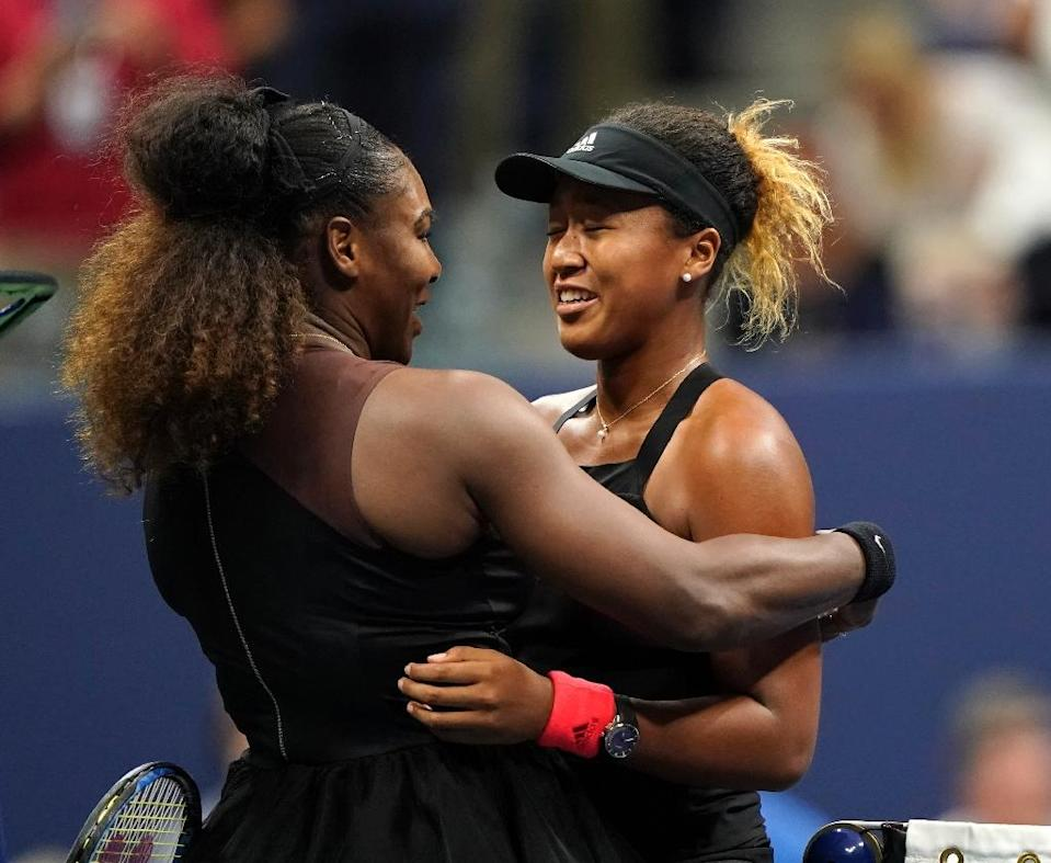 Naomi Osaka of Japan (R) and Serena Williams of the US meet at the net after their 2018 US Open women's singles final match in New York (AFP Photo/Eduardo MUNOZ ALVAREZ)