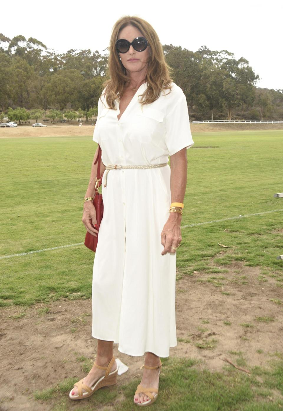 <p>For an end of summer soiree, Caitlyn Jenner gave a white linen dress one last run. She paired it with a gold belt, wedge sandals, and round sunglasses. </p>