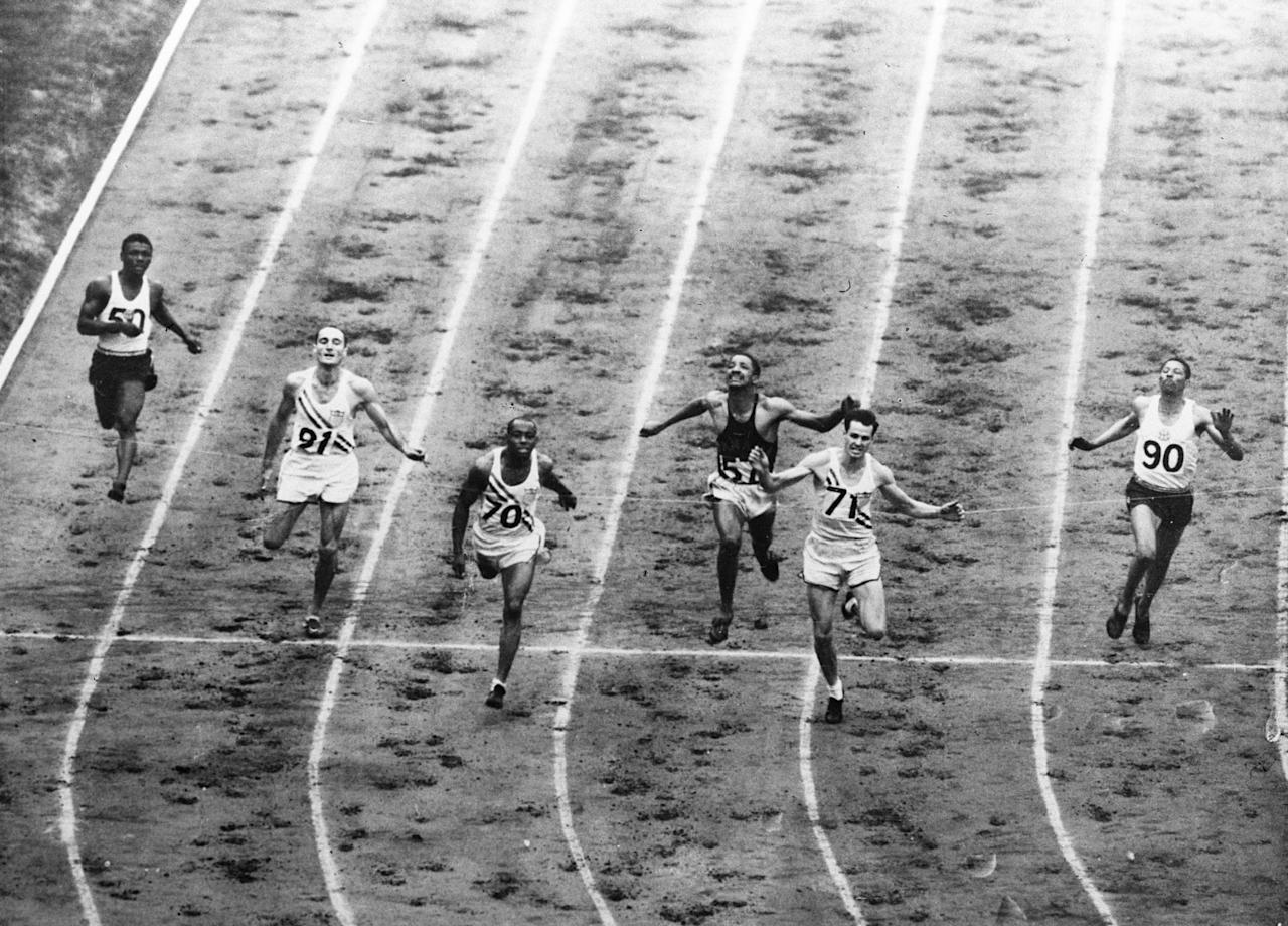 "This overhead view of the 200-meter dash finish line shows how American Mel Patton (71) of Southern Calif., nosed out teammate H. Norwood ""Barney"" Ewell (70) of Lancaster, Pa., by a half-stride in the Summer Olympics, August 3, 1948.  Left to right are: Leslie Laing (50) of Jamaica, Cliff Bourland (91) of Los Angeles, Ewell, Lloyd LaBeach (57) of Panama, who finished third, Patton, and Herb McKenley (90) of Jamaica.  Both Patton and Ewell were clocked in 21.1 secs. for the event in Wembley Stadium, London.(AP Photo)"