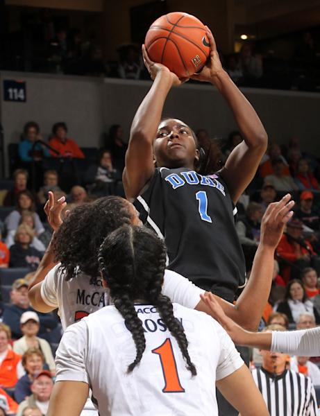 Duke center Elizabeth Williams (1) shoots over Virginia guard China Crosby and forward Telia McCall during an NCAA college basketball game Friday, Feb. 8, 2013, in Charlottesville, Va. (AP Photo/Andrew Shurtleff)