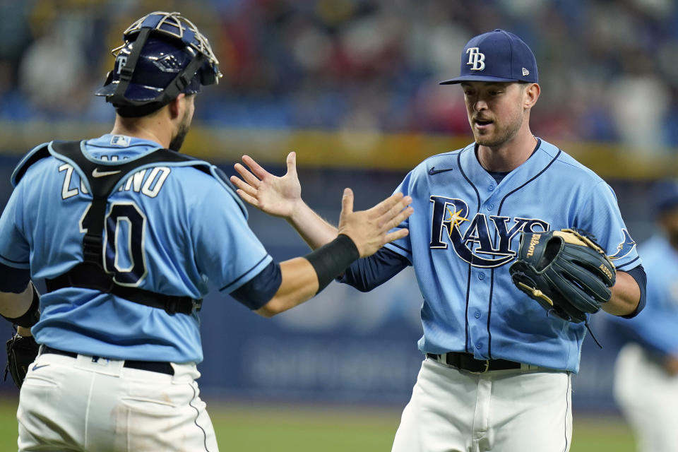 Tampa Bay Rays relief pitcher Jeffrey Springs, right, celebrates with catcher Mike Zunino (10) after the Rays defeated the Boston Red Sox during a baseball game Friday, July 30, 2021, in St. Petersburg, Fla. (AP Photo/Chris O'Meara)