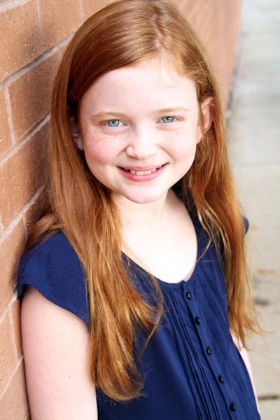 """In this undated publicity image, actress Sadie Sink poses for a photo. Sink and fellow actress Taylor Richardson will share the title role in """"Annie,"""" the stage's most famous redhead beginning July 30. They replace Lilla Crawford, whose last performance will be on July 28. (AP Photo/Boneau/Bryan-Brown)"""
