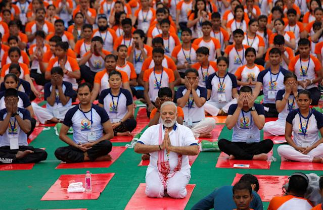 <p>Indian Prime Minister Narendra Modi performs yoga on International Yoga Day in Lucknow, India, June 21, 2017. (Photo: Pawan Kumar/Reuters) </p>