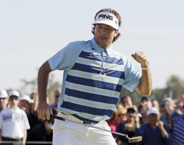 Bubba Watson celebrates his birdie putt on the 18th green on his way to victory in the Northern Trust Open golf tournament at Riviera Country Club in the Pacific Palisades area of Los Angeles, Sunday, Feb. 16, 2014. Watson carded a 15-under-par 269, two strokes ahead of the second-place finisher. (AP Photo/Reed Saxon)