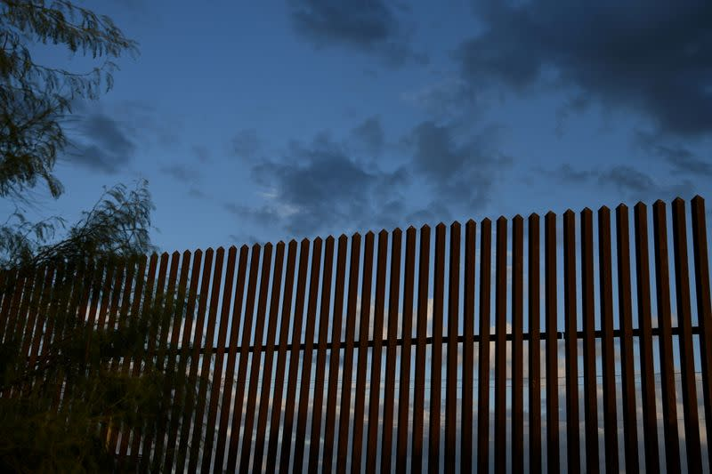 FILE PHOTO: A section of border fence is pictured by the U.S.-Mexico border in the Rio Grande Valley near Hidalgo