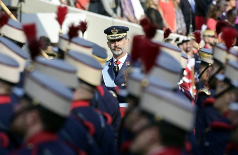 Spain's King Felipe VI reviews the troops during the Spanish National Day military parade in Madrid on October 12, 2017