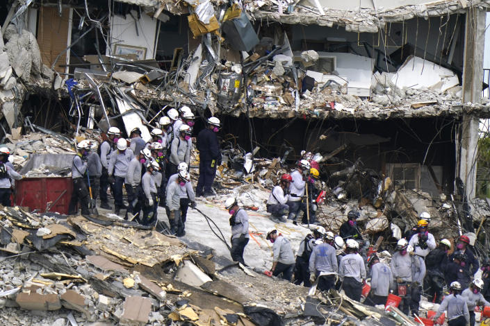 Rescue workers search in the rubble at the Champlain Towers South condominium Monday (AP Photo/Lynne Sladky)