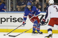 New York Rangers center Mika Zibanejad (93) prepares to pass with Columbus Blue Jackets defenseman Seth Jones (3) looking on during the second period of an NHL hockey game, Sunday, Jan. 19, 2020, in New York. (AP Photo/Kathy Willens)