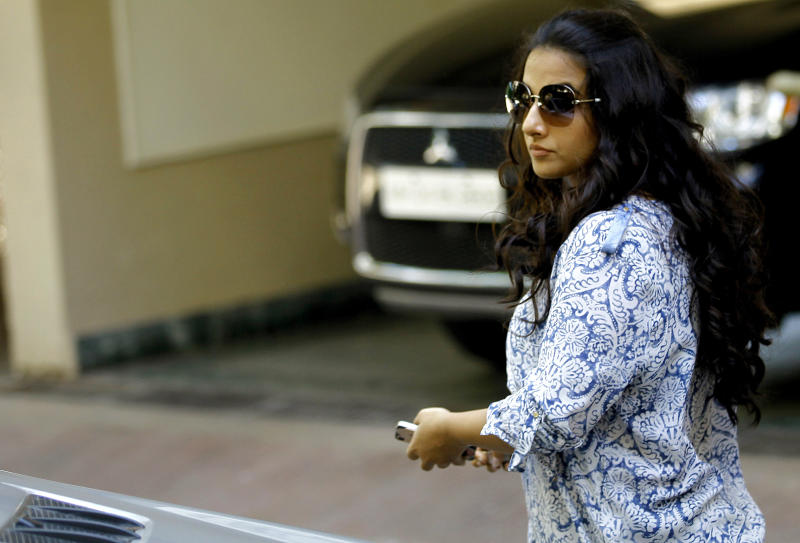 Bollywood actress Vidya Balan leaves the residence of actor Sanjay Dutt in Mumbai, India, Thursday, March 21, 2013. India's Supreme Court on Thursday upheld the weapons conviction of Dutt and ordered him to report to prison within four weeks in a case linked to the deadliest terror attack in Indian history. Dutt's failed appeal of his conviction was part of a broader ruling by the Supreme Court on cases stemming from the 1993 bombings that killed 257 people in the financial hub of Mumbai. (AP Photo/Rafiq Maqbool)