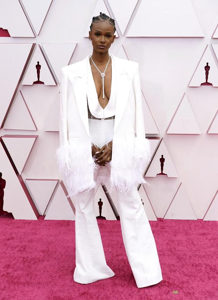 Tiara Thomas in a white pantsuit with a plunging neckline