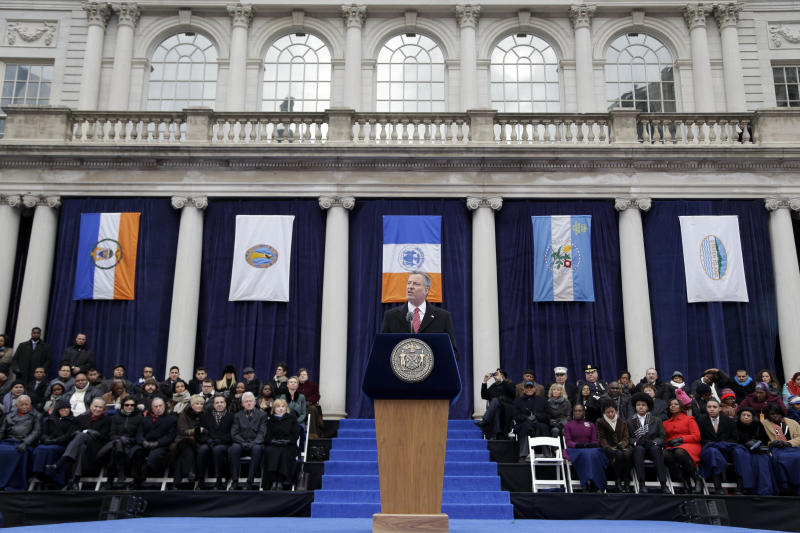 FILE- In this Jan. 1, 2014 file photo, New York City Mayor Bill de Blasio speaks after being sworn in during the public inauguration ceremony at City Hall in New York. Hours after taking his official oath of office in front of his home in an informal setting, the media-savvy mayor arrived for his formal inauguration on the steps of New York City Hall by subway. (AP Photo/Seth Wenig, File)