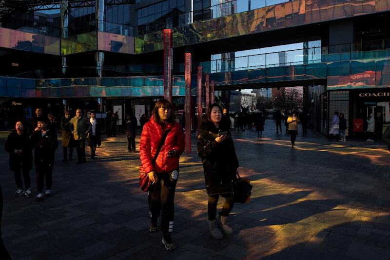 China's normally steady unemployment rate rose to 5.3 percent in February while retail sales growth remained near a 15-year low (AFP Photo/NICOLAS ASFOURI)