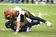 Baltimore Ravens linebacker Tyus Bowser, back, records a sack on Cincinnati Bengals quarterback Joe Burrow as he tries a pass during the first half of an NFL football game, Sunday, Oct. 11, 2020, in Baltimore. (AP Photo/Nick Wass)