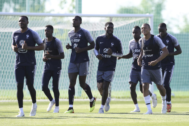 France's players run on the field during a training session at the 2018 soccer World Cup in Istra, Russia, Monday, June 18, 2018. (AP Photo/David Vincent)