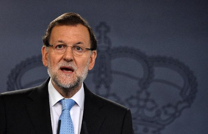 Spanish Prime Minister Mariano Rajoy speaks during a press conference held after an extraordinary meeting with his government, at the Moncloa Palace in Madrid on November 11, 2015 (AFP Photo/Gerard Julien)