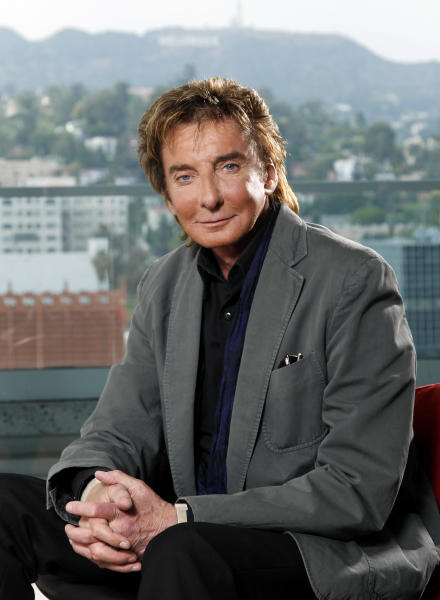 """FILE - This June 8, 2011 file photo shows musician Barry Manilow poses for a portrait in Los Angeles. The Grammy Award-winning singer of such songs as """"Mandy,"""" ''I Write the Songs"""" and """"Looks Like We Made It,"""" will start a 17-performance stand on Jan. 18 at the St. James Theatre. Manilow, who grew up in New York, has graced a Broadway stage before, in the winter of 1976 and the spring of 1989. His new show, called """"Manilow on Broadway,"""" has tickets ranging in price from $50 to $350. (AP Photo/Matt Sayles, file)"""